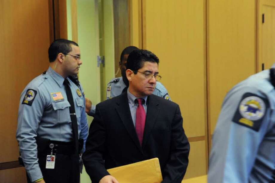 Defendant Carlos Trujillo enters the courtroom at state Superior Court in Stamford, on the first day of his murder trial in the slaying of Andrew Kissel, on Tuesday, Nov. 30, 2010. Photo: Helen Neafsey / Greenwich Time