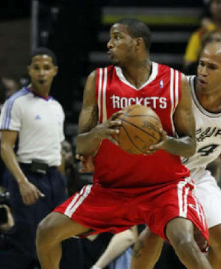 New Spurs acquisition Richard Jefferson guards Houston Rockets guard Trevor Ariza during Tuesday's preseason game.