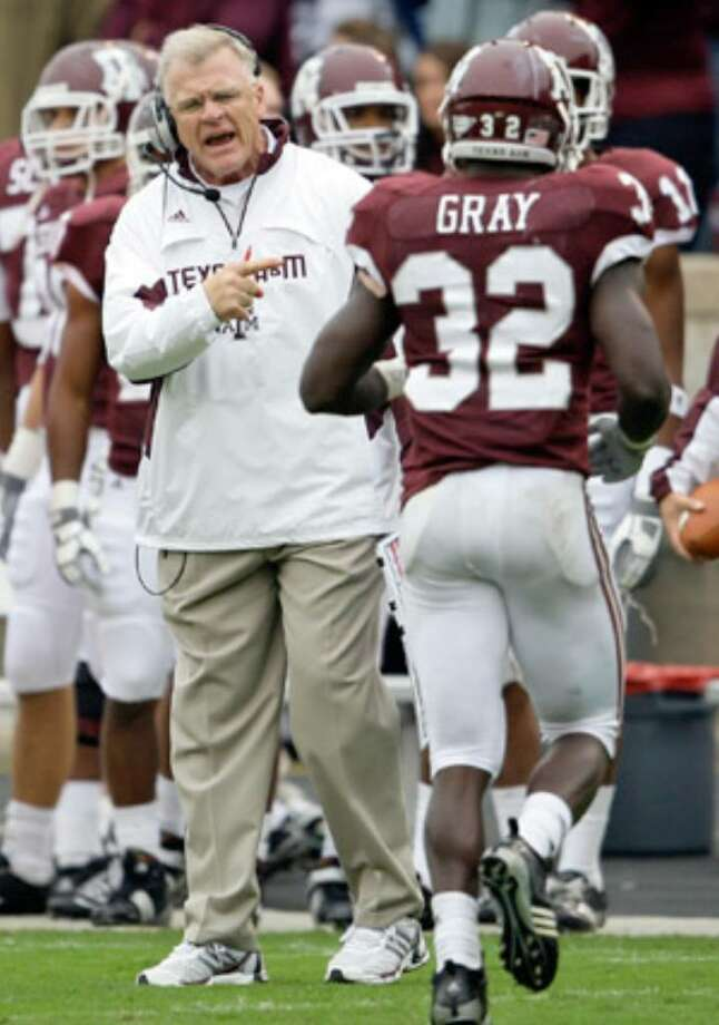 Coach Mike Sherman, yelling at running back Cyrus Gray as he leaves the field Saturday against OSU, has been piping in crowd noise to prepare A&M for its first true road game.