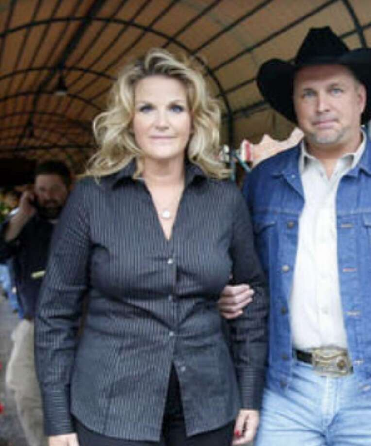 """""""An icon for all parents"""": That's how one reader views country music star Garth Brooks, with wife and fellow performer Trisha Yearwood."""