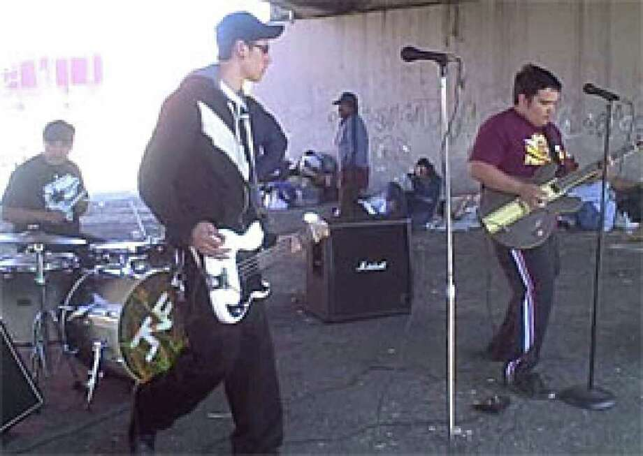 The band Junes Not Faking has been playing free concerts for homeless people under the Commerce Street Bridge.