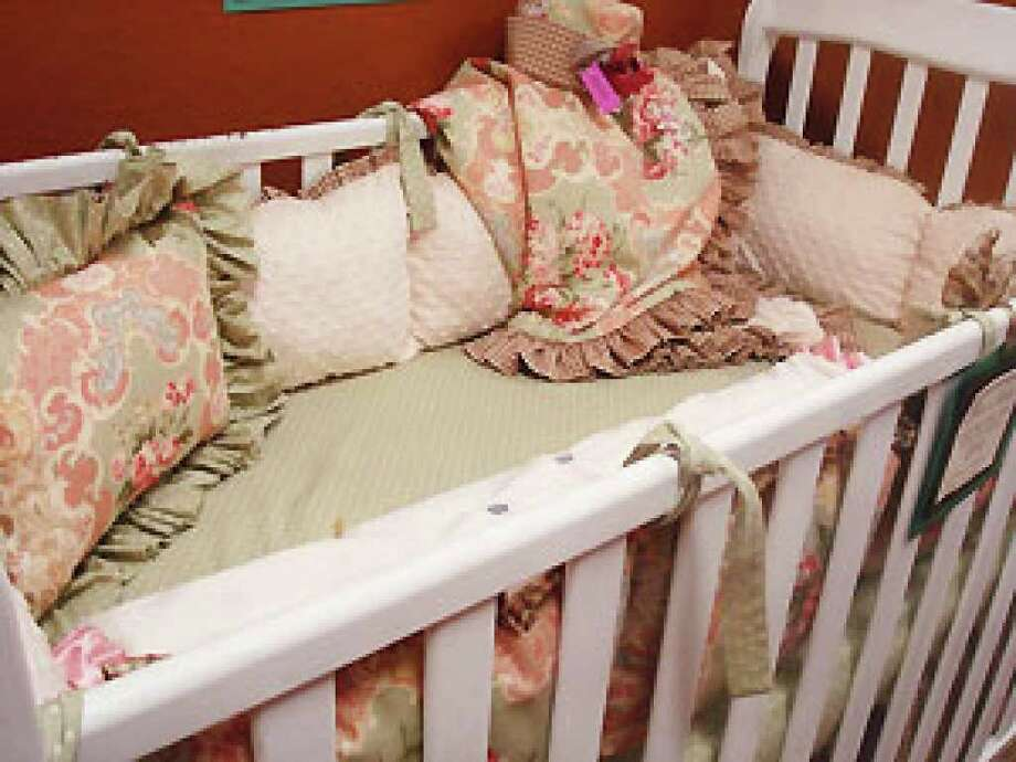 Invitation Chicks' baby section features this custom crib bedding set, $550.