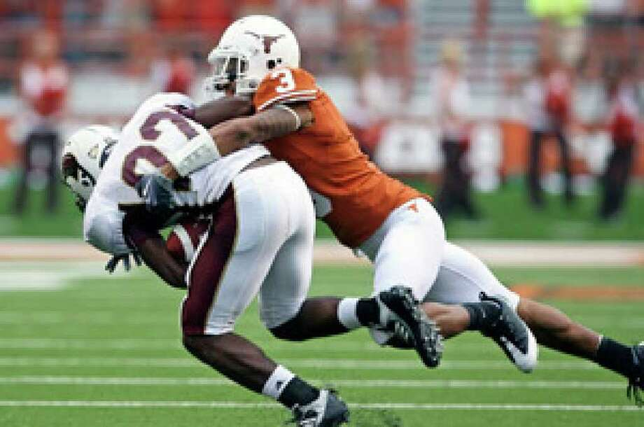 Texas' Curtis Brown brings down a runner for the University of Louisiana Monroe at Texas Memorial Stadium in Austin in September.