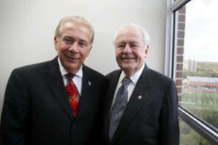 Incarnate Word president Louis Agnese (left) and New Orleans Saints owner Tom Benson helped make football at Incarnate Word a reality.