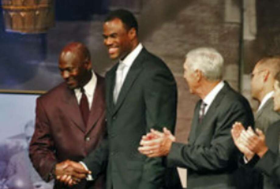David Robinson (second from left) greets fellow inductee Michael Jordan alongside the rest of this year's class at the reunion dinner Thursday night.