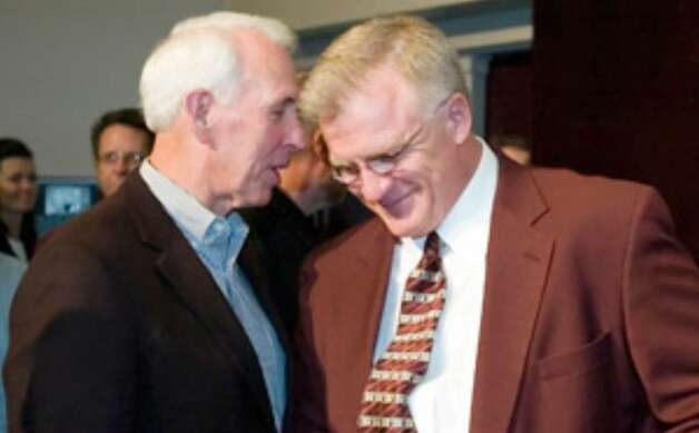 Former Aggies coach R.C. Slocum (left) will help Mike Sherman but is careful not to meddle with the team.
