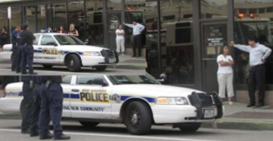 Employees at a downtown building that houses Bexar County offices were evacuated for about an hour Thursday morning, when a man threw two lit smoke flares at a receptionist.