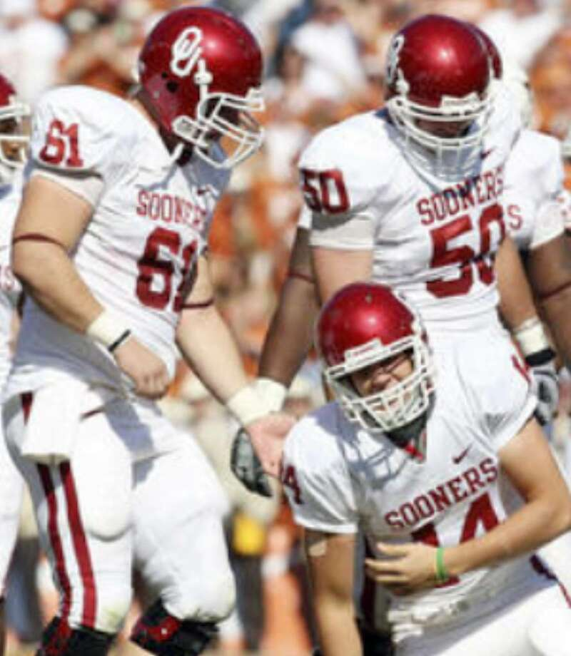 OU quarterback Sam Bradford grimaces in pain after being sacked by UT cornerback Aaron Williams on Saturday. The hit knocked Bradford out the game, and he did not return.