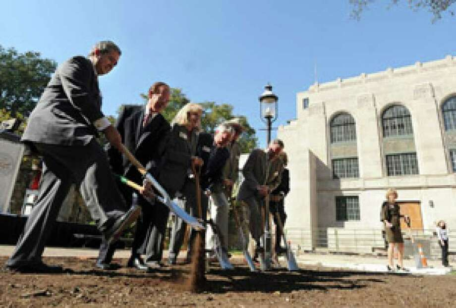Former Gov. Dolph Briscoe's daughter Janey Briscoe Marmion (center) and other dignitaries break ground for the Dolph and Janey Briscoe Western Art Museum at the historic San Antonio Water System Market Street Pump Station.