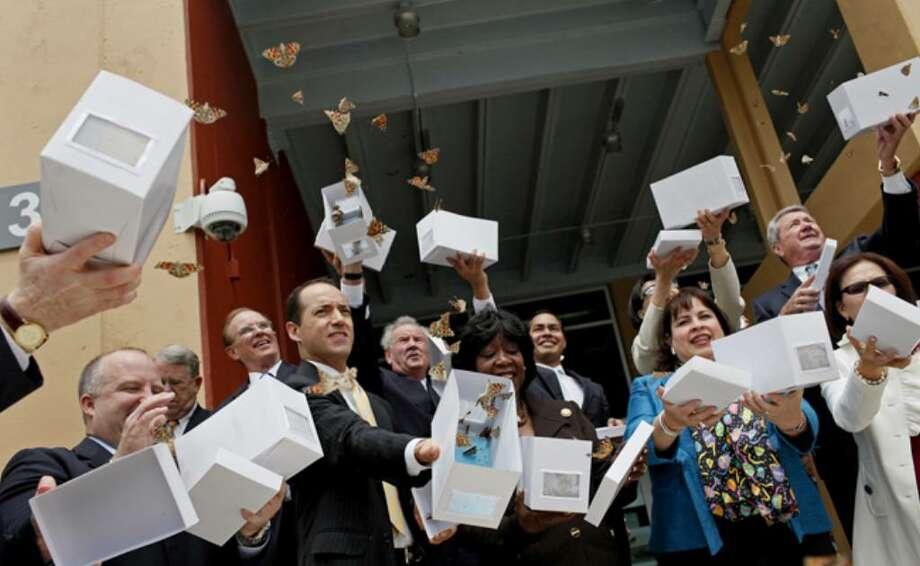 Local and state officials release butterflies during the Haven for Hope dedication ceremony.