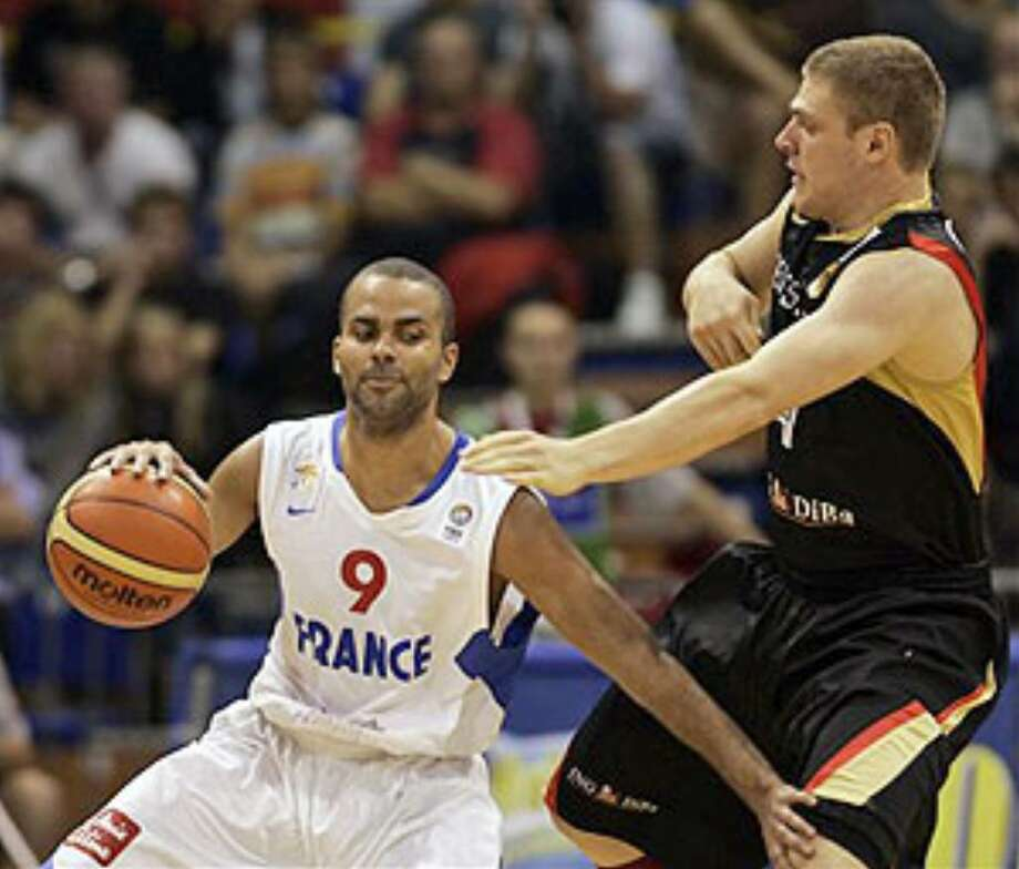 France's Tony Parker (left) drives around Germany's Lucca Staiger in their European basketball championships opener on Monday.