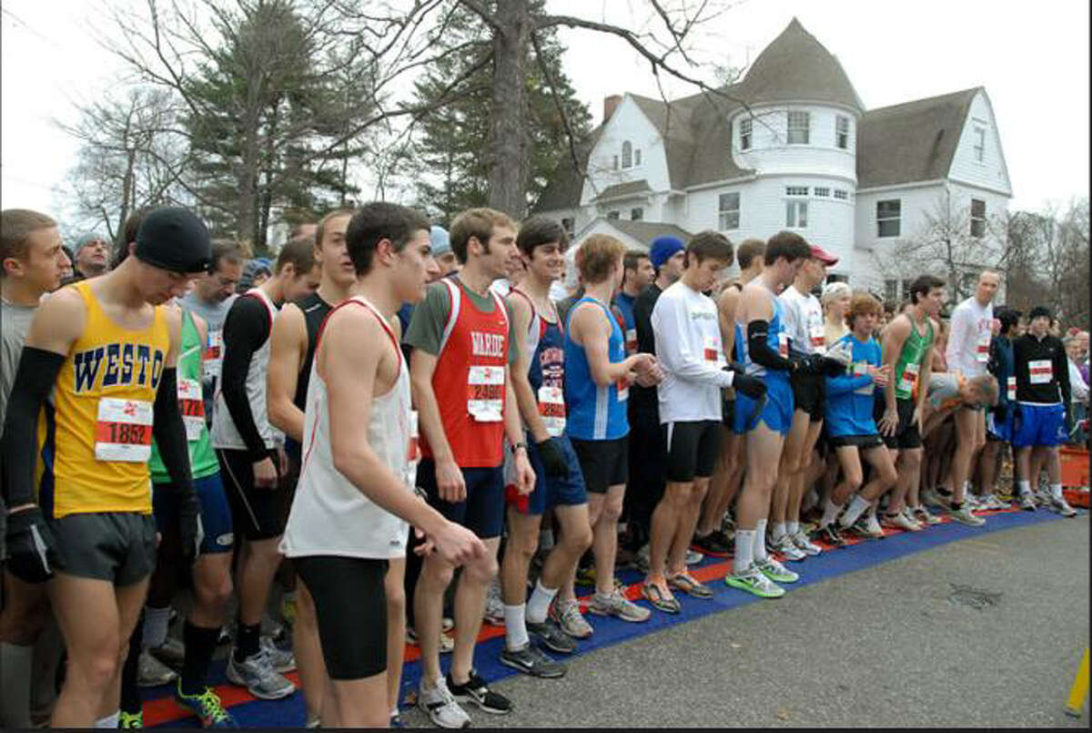 Weston cross country and track senior captain Steve Vento, left prepares for the 33rd annual Pequot Runners Thanksgiving Road Race where he placed eighth with a time of 27:19.