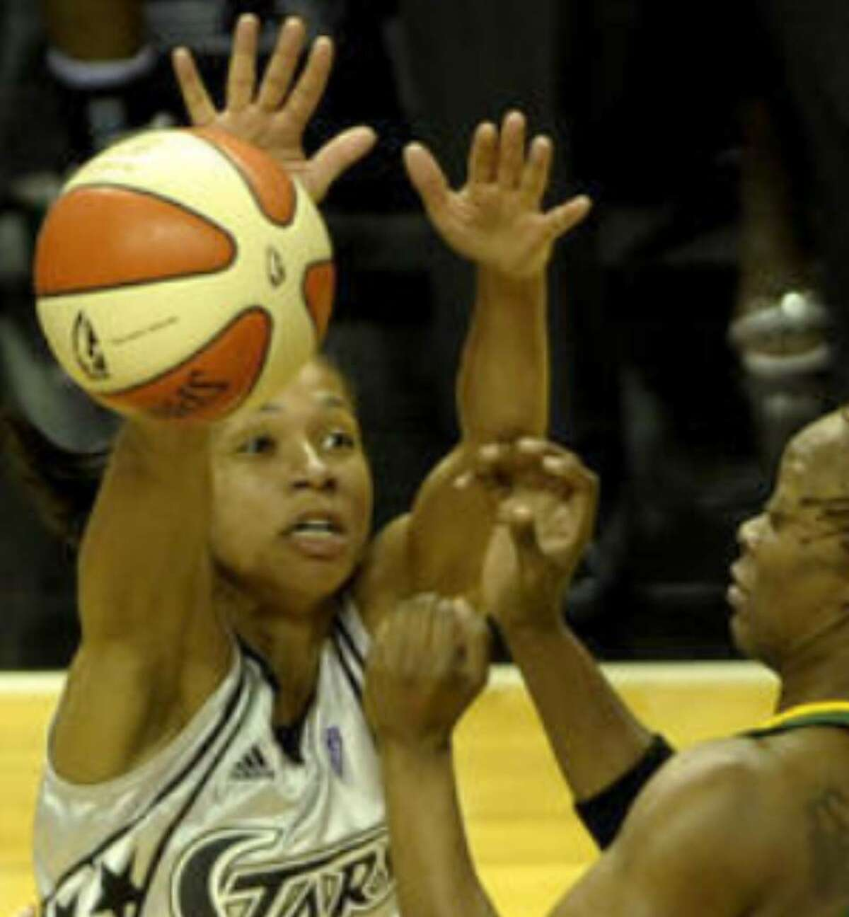 Silver Stars guard Edwige Lawson-Wade (left) deflects a pass away from the Seattle Storm's Shannon Johnson last weekend at the AT&T Center.