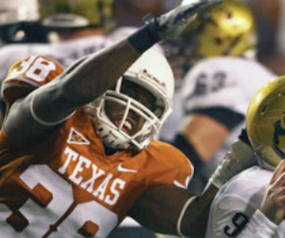 Texas linebacker Roddrick Muckelroy attempts to sack Colorado quarterback Tyler Hansen, getting a piece of his helmet in the process, to draw a penalty. The Texas defense made life tough on Colorado throughout the night to improve to 2-0 in Big 12 play.