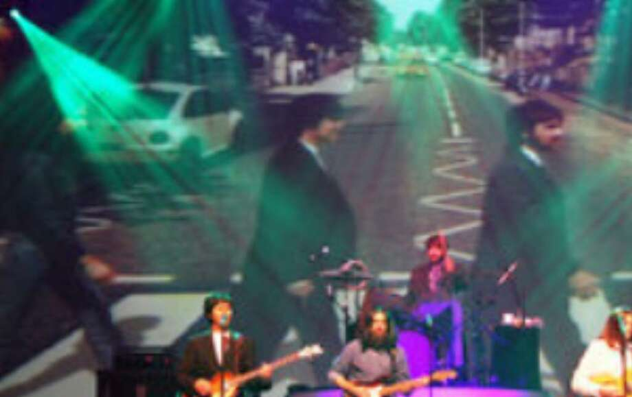 "Joey Curatolo (from left), Joe Bithorn, Ralph Castelli and Steve Landes re-create ""Abbey Road""-era Beatles in a scene from ""Rain."" Mark Lewis (right), is the band's founder."