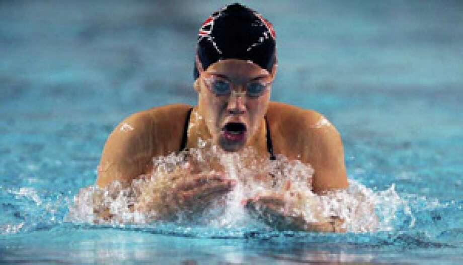 Churchill's Kim Pavlin, who won gold in the 200 individual medley at state last season, won at the Duel with a time of 2:06.92. She was an E-N co-girls swimmer of the year as a junior.