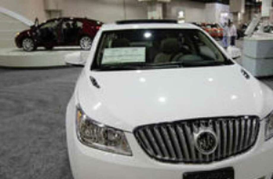 Ruby Warnes gets a closer look at a 2010 Buick LaCrosse at the San Antonio International Auto & Truck Show. Warnes said that she really liked the chrome treatment on the vehicle.