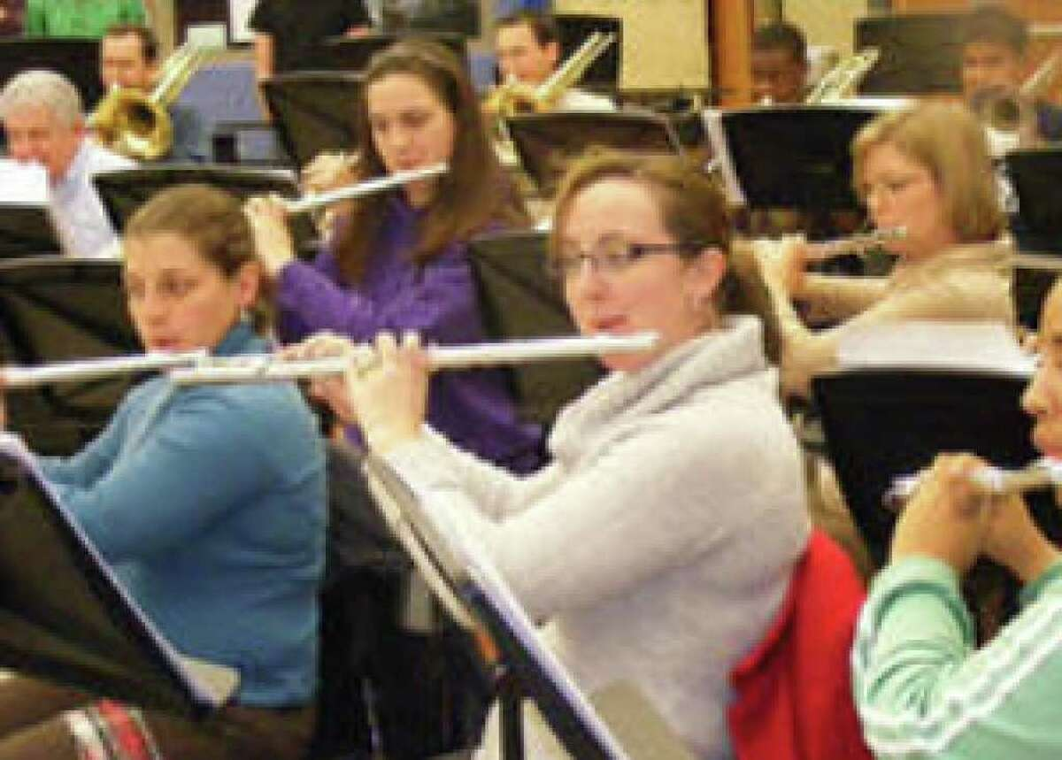 Heart of Texas Concert Band musicians (from left) Bari Douglas, Amy Mullen, Kelly Rogers, Liz Hanovice and Stephanie Key play during a recent band rehearsal.