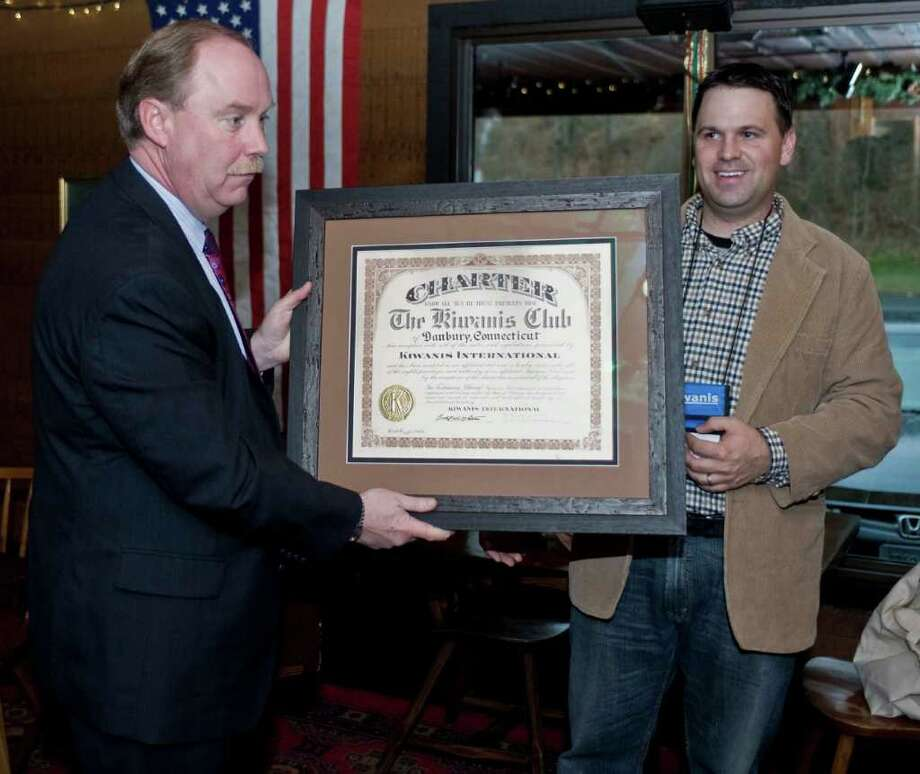 State Sen. Michael McLachlan and Kiwanis President Paul S. Caso with the original Kiwanis charter from Oct. 15, 1942. State Senator McLachlan presented it to club members following their weekly Tuesday luncheon at Chuck's Steak House. Tuesday, Nov. 30, 2010 Photo: Scott Mullin / The News-Times Freelance