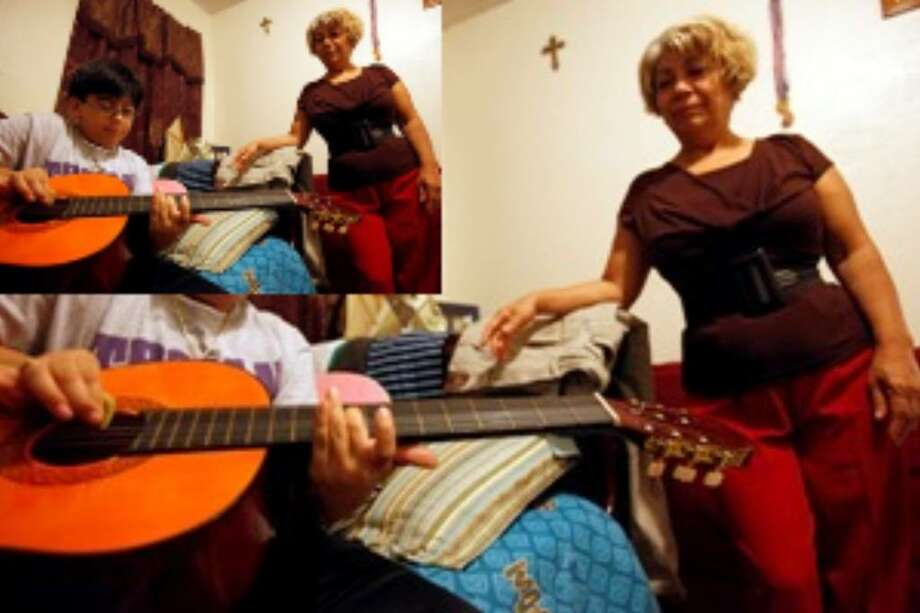 Gertrudis Iglesias, watching son Ariel Salazar play guitar, used the Medical-Legal Assistance for Families program.