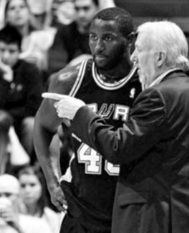 DeJuan Blair, talking with coach Gregg Popovich during Friday's game, returned from a bruised tailbone injury.