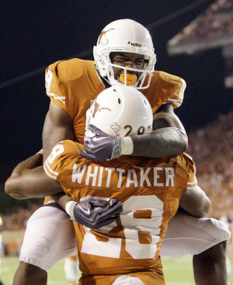 Malcolm Williams, celebrating with Fozzy Whittaker, is working hard to improve his catching.