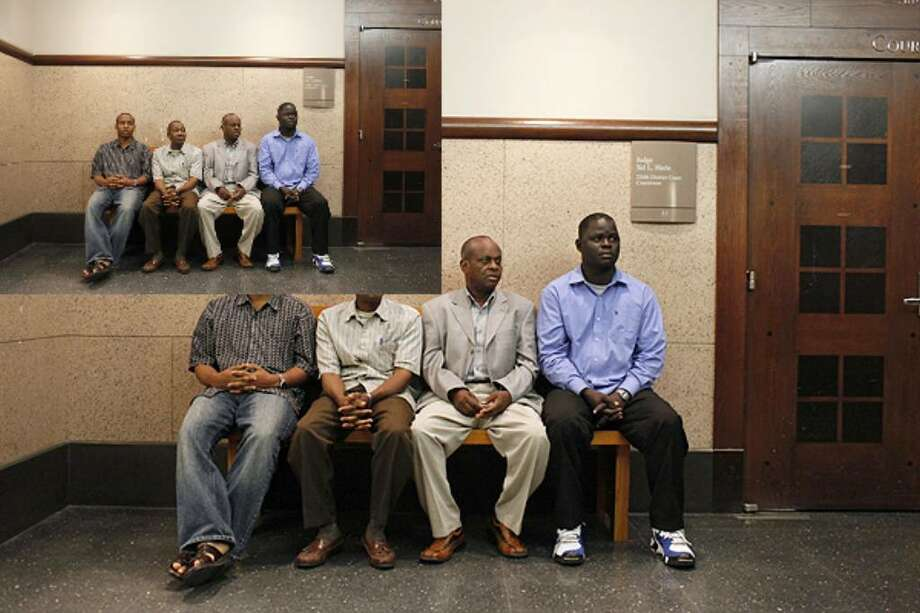 Refugees from Somalia who have resettled in San Antonio including Ali Abukar, (from left) Abdirahman Ibrahim, Ahmed Yusuf, and Hassan Abdirahman wait to testify in the trial for pharmacist Marcelleus J. Anunobi in the 227th district courtroom on Wednesday. Yusuf did not testify but accompanied the men as the representative from the Somali Bantu Association of San Antonio.