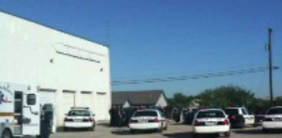 A San Antonio Police officer was injured when  suspect kicked out the back window of her patrol car.
