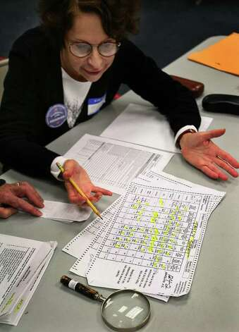 Melinda Valencia of Glastonbury looks at the tally sheet for District 124-2 Harding High School during the election recount at the City Hall Annex in Bridgeport on Tuesday, November 30, 2010. Photo: Brian A. Pounds / Connecticut Post
