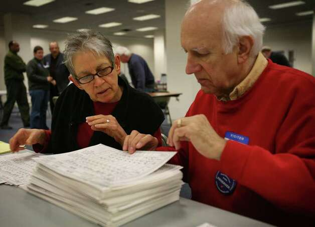 Zazu Gray and her husband Nicholas Pyndus of Milford, examine ballots as part of the election recount at the City Hall Annex in Bridgeport on Tuesday, November 30, 2010. Photo: Brian A. Pounds / Connecticut Post