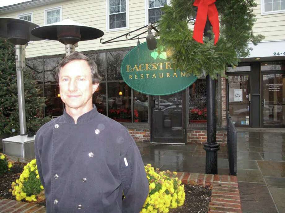 David Johnson, owner of Backstreet Restaurant on Center street in Darien, takes a break after lunch service Tuesday. Johnson said business has increased due to Darien Restaurant Week. Photo: File Photo / Darien News