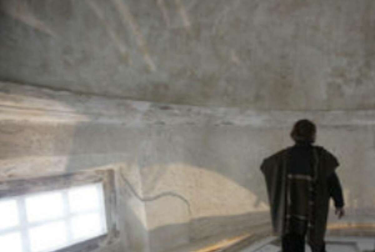 Peterson walks in the dome of Mission Concepción. Preservation work lets her commune with craftsmen of the past.