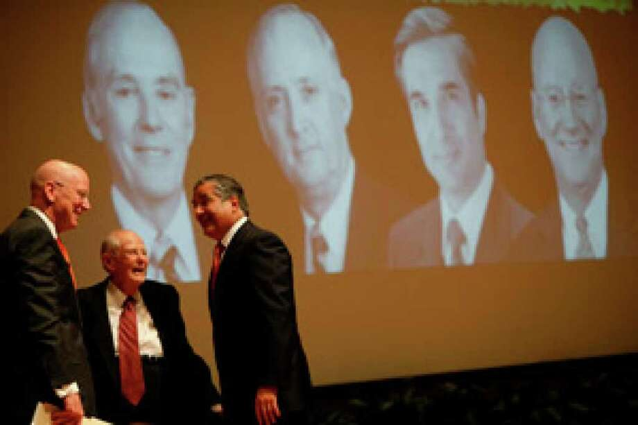 The current UTHSC president, Dr. William Henrich (from left), talks with two of the former presidents, Dr. Frank Harrison and Dr. Francisco Cigarroa, during the ceremony.