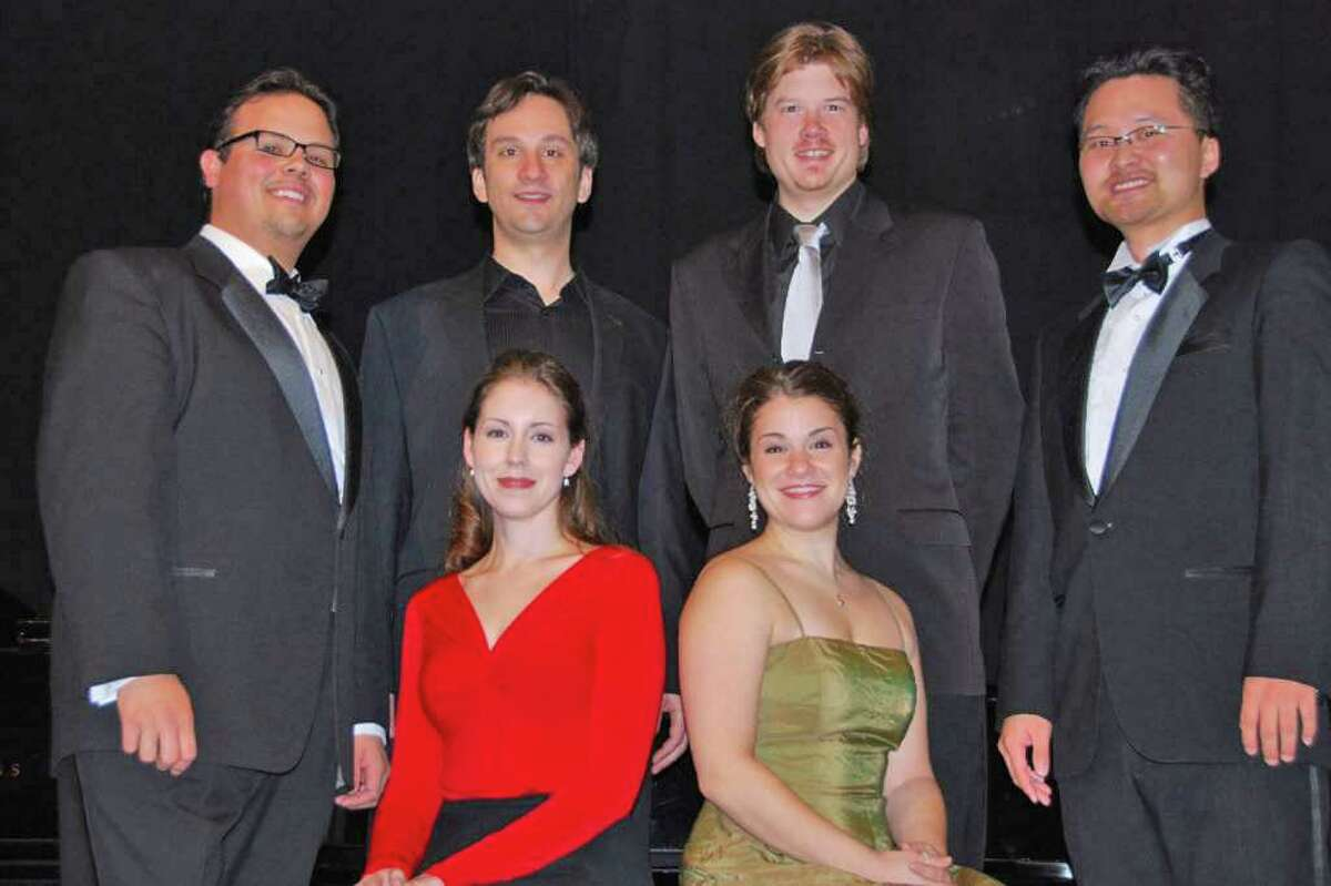 The 2008 winners of the Heida Hermanns International Voice Competition included, from left, front row, Chloe Moore and Rebecca Jo Loeb; from left, second row, David Portillo, Jorge Prego, Steve Ebel and Yohan Yi. The winners came from around the country, as well as South Korea and Canada. This year's competition runs Saturday and Sunday, Dec. 4 to 5, at the Westport Town Hall. Contributed photo/Phyllis Groner