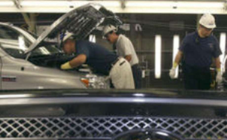 Workers at Toyota Motor Manufacturing of Texas work on Tundras. Toyota is adding around 1,000 new jobs at the South Side plant next year.