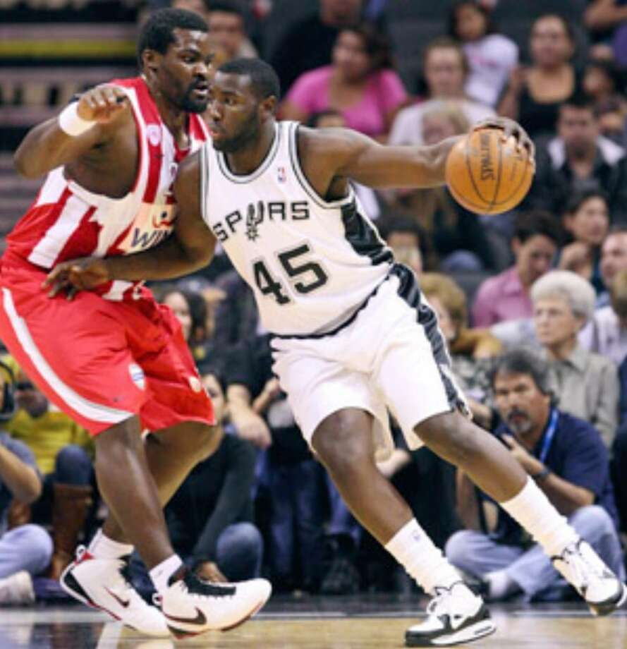 Spurs rookie forward DeJuan Blair, shown going against Olympiacos' Sofoklis Schortsanitis last week, will face off against top overall pick Blake Griffin when the Clippers come to the AT&T Center for tonight's preseason matchup.
