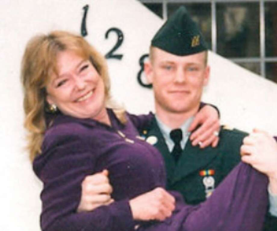 Home on leave, Clayton P. Bowen lifts his mother, Reesa Doebbler, in this 1999 photo.