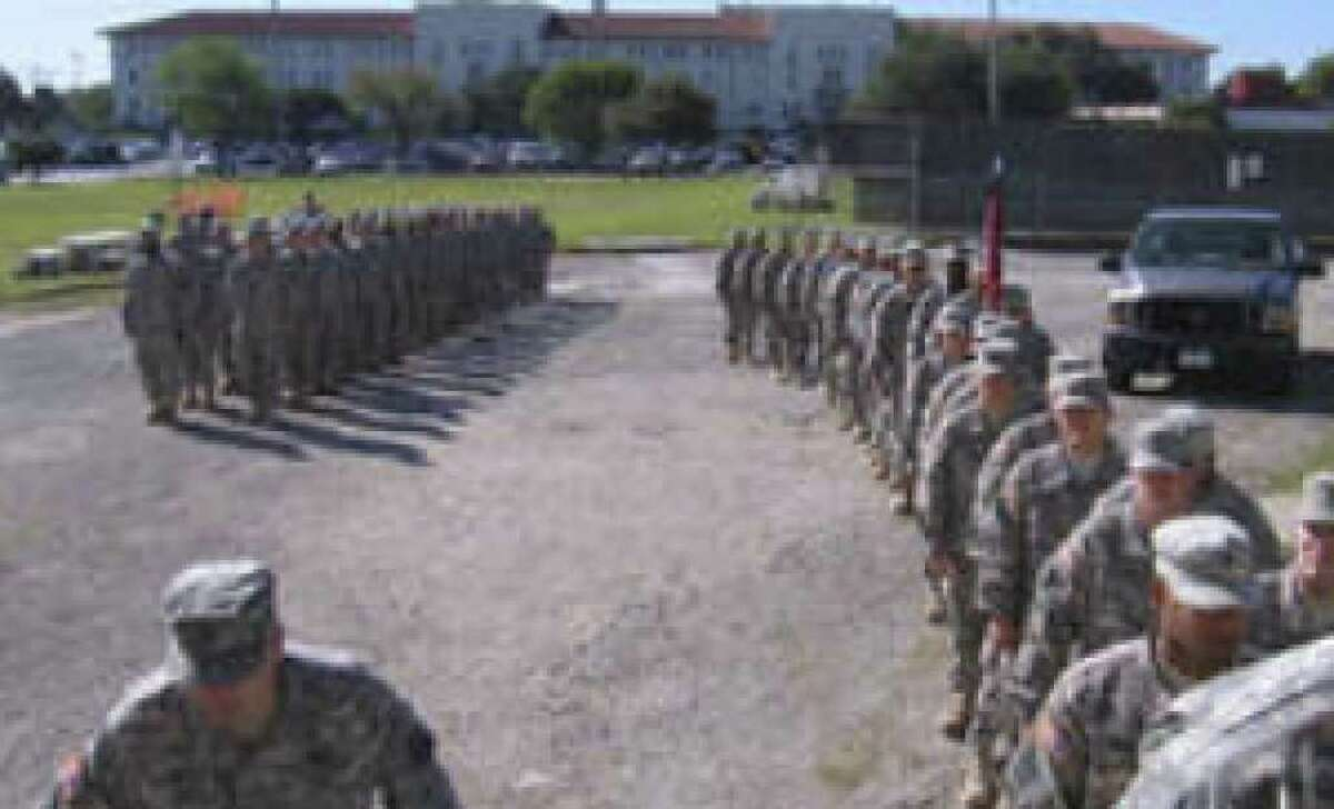 Soldiers with the 418th Medical Logistics Company stand in formation outside the Roadrunner Community Center at Fort Sam Houston before the ceremony.