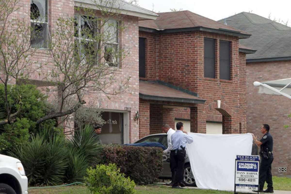Investigators remove the mother's body from the scene of an apparent double-murder suicide involving a mother and two children in the 12000 block of Gable Oaks.