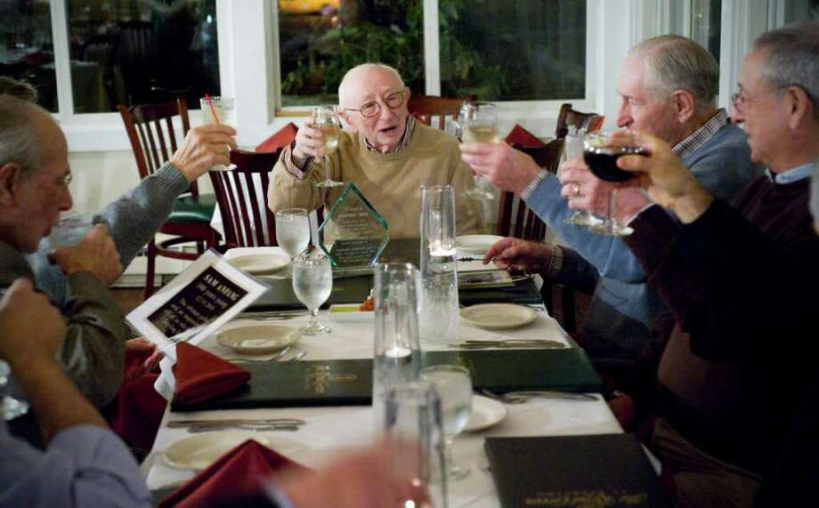 Longtime golfer Sam Anfang, who turns 100 years old in December, celebrates his birthday with a group of friends, including his golf foursome, at The Royal Green Restaurant at Sterling Farms Golf Course in Stamford, Conn. on Tuesday November 30, 2010.  The golf authority presented Anfang with free golfing rights and a a plaque to be put on the first hole. Photo: Kathleen O'Rourke / Stamford Advocate