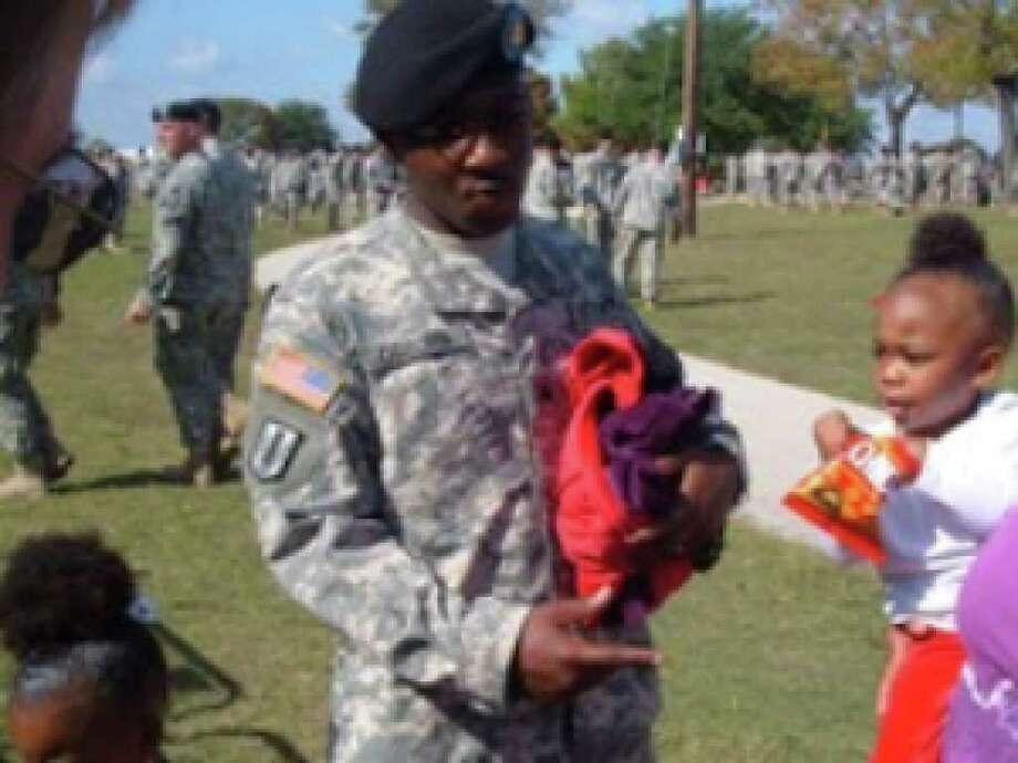 Sgt. Perry Osburn, his wife Megan, and their children attended the Fort Hood memorial service.
