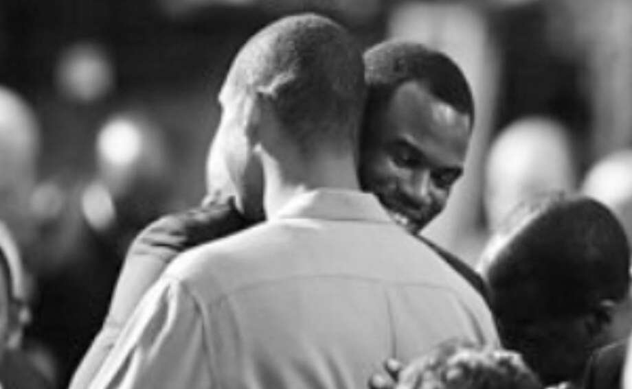 David Robinson hugs ex-teammate Tim Duncan before Robinson's Hall of Fame enshrinement Friday.