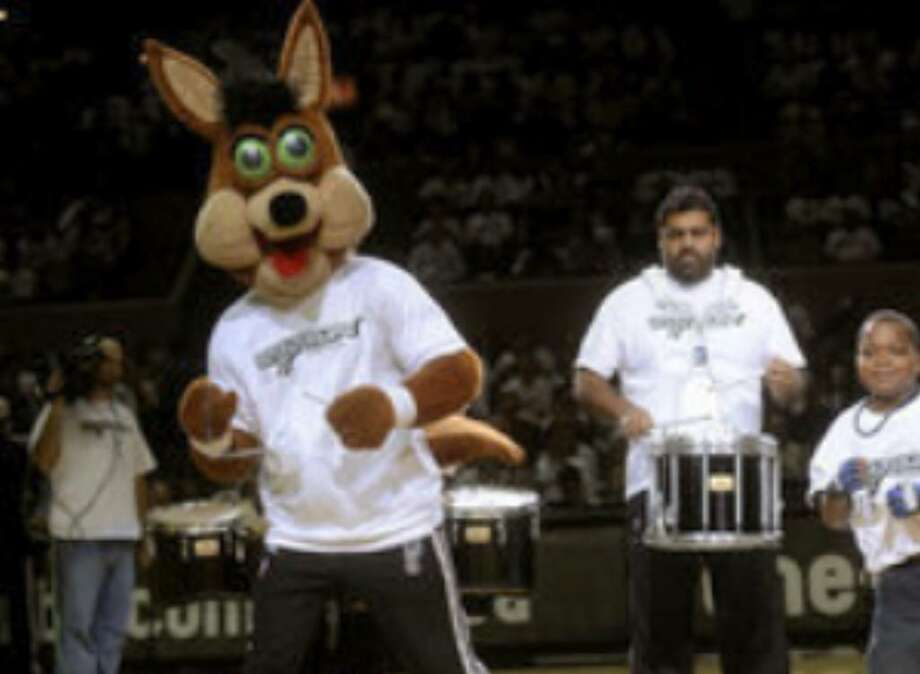 "William ""B.J."" Gabriel, 10, dances with the Spurs Coyote during a time-out at the Spurs season opener at the AT&T Center. B.J.'s talents were displayed when he danced at a preseason game two weeks ago."