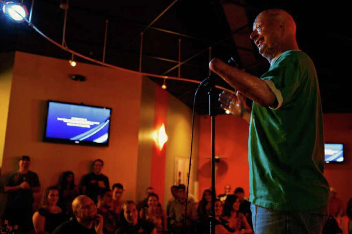 Army Staff Sgt. Bobby Henline entertains the audience during open-mike night at the Laugh Out Loud Comedy Club in San Antonio.