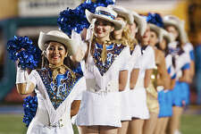 The Alamo Heights Spurs Dance Team cheers during player introductions.