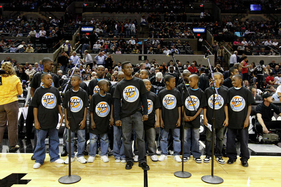 Les Petits Chanteurs, from Holy Trinity Music School in Port-au-Prince, Haiti, line up to perform the National Anthem before the start of the San Antonio Spurs\Chicago Bulls game at the AT&T Center, Wednesday, Nov. 17, 2010. They are trying to raise money for band instruments and rebuild their school destroyed in the Jan. 12 earthquake. / glara@express-news.net