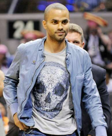 The Spurs' Tony Parker leaves near the end of the Silver Stars-Atlanta Dream WNBA game on May 15 at the AT&T Center. The Dream won 75-70.