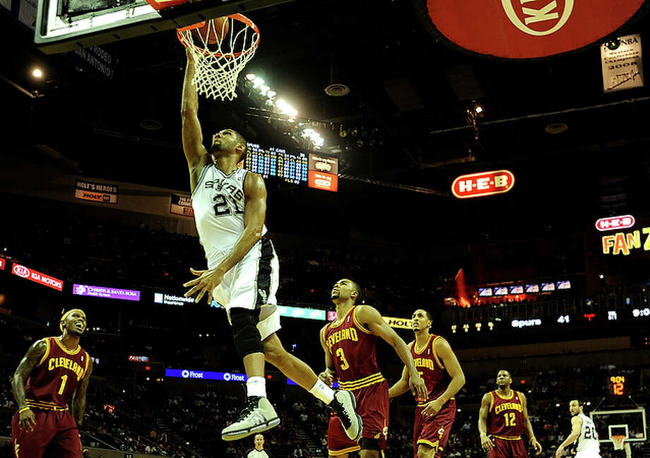 Tim Duncan of the San Antonio Spurs scores on a fast break against the Cleveland Cavaliers during first-half NBA action at the AT&T Center on Saturday, Nov. 20, 2010. Duncan scored eight points.