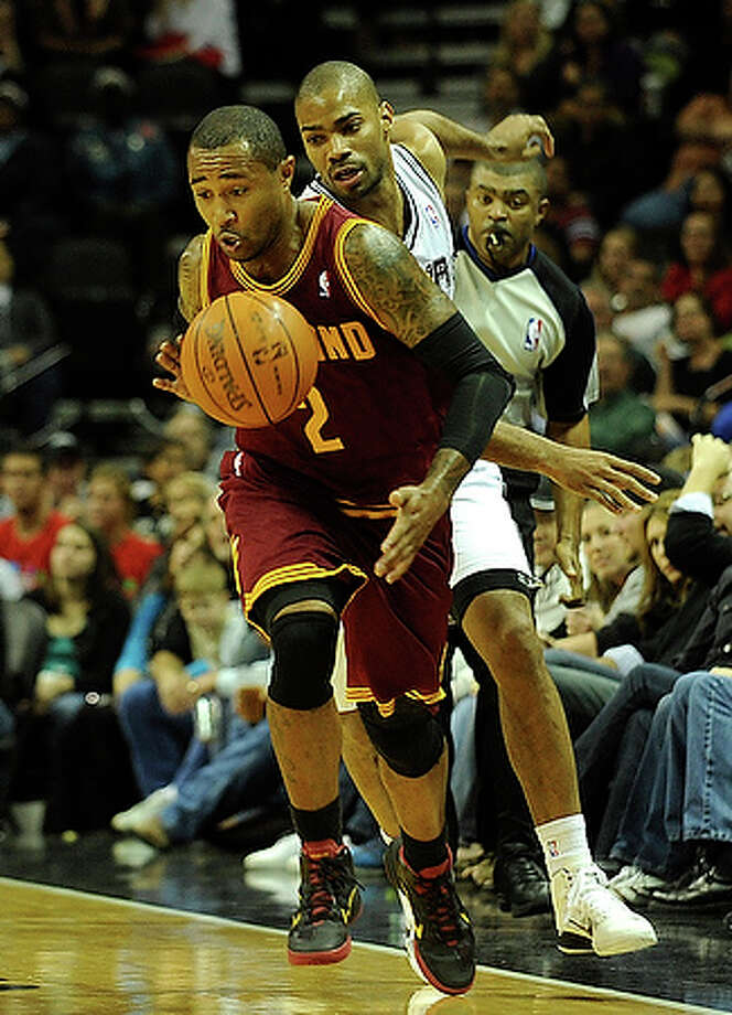 Mo Williams (2) of the Cleveland Cavaliers steals the ball from Gary Neal of the San Antonio Spurs.