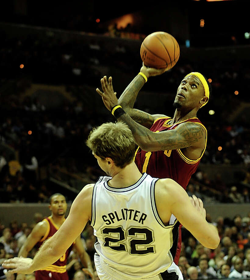 Daniel Gibson of the Cleveland Cavaliers (1) shoots over Tiago Splitter of the San Antonio Spurs. Gibson scored 17.